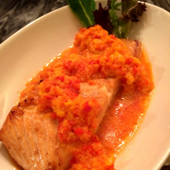 bell pepper puree on pan fried salmon