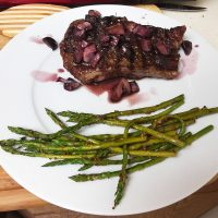 Strip Steak with Red Wine Mushroom Sauce and Mustard Roasted Asparagus