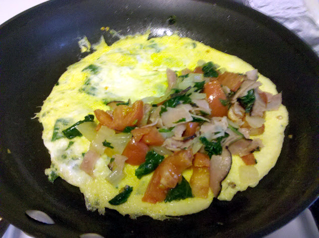 Making spinach omelette