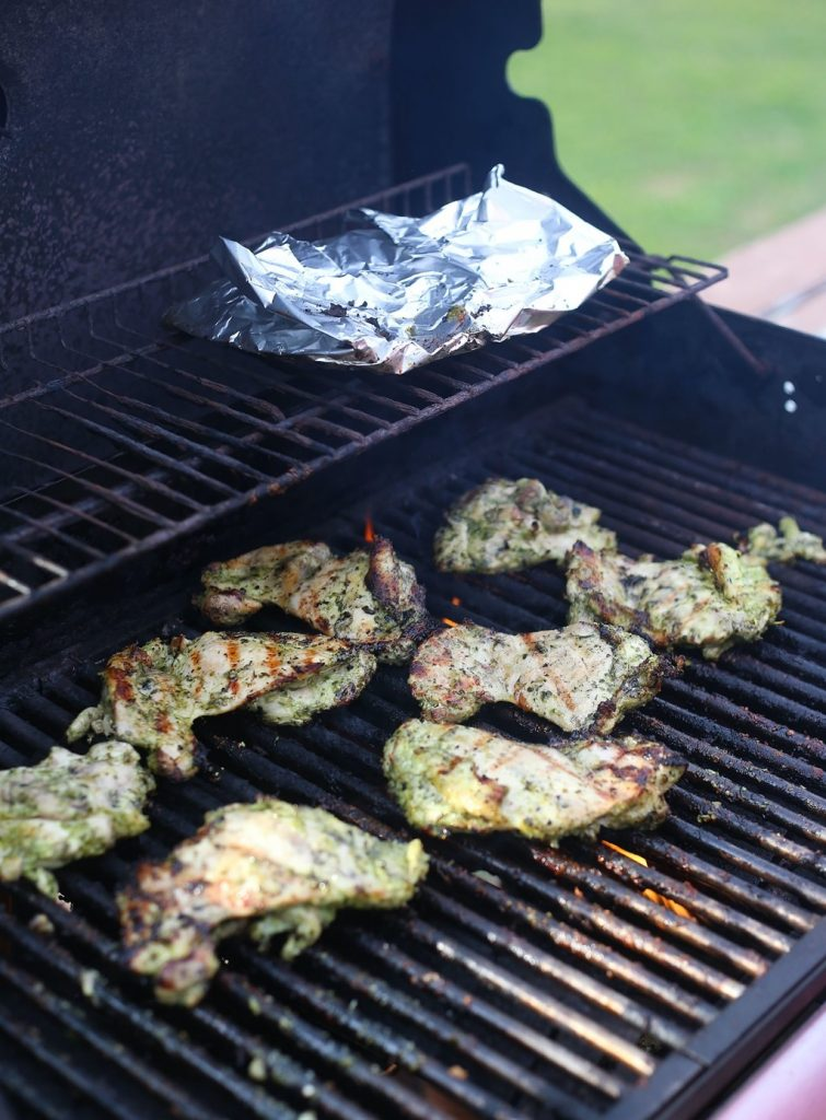 A pan of food on a grill  Description automatically generated