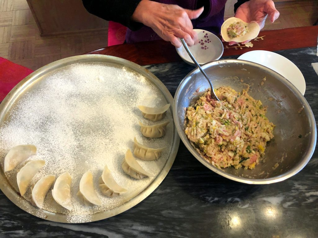 Learn how to make delicious Chinese Pork Dumplings, Potstickers, and the yummy dipping sauce that goes with it with this recipe!